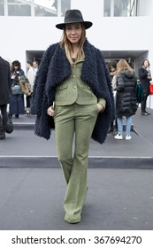 Stylish young woman wearing a winter look is pictured during the Mercedes-Benz Fashion Week Berlin Autumn/Winter 2016 at Brandenburg Gate in Berlin, Germany on January 21, 2016.