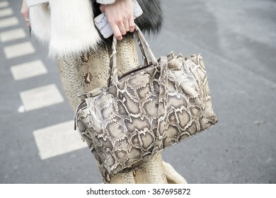 Stylish young woman wearing a winter look is pictured during the Mercedes-Benz Fashion Week Berlin Autumn/Winter 2016 at Brandenburg Gate in Berlin, Germany on January 21, 2016. Snakeskin details