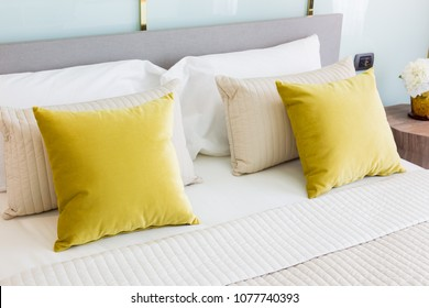 Stylished bed and pillow in bed room in luxury resort.