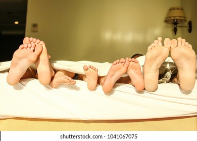 Stylishly beautiful legs on bed background