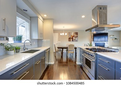 Stylishly updated kitchen with quartz countertops and stainless steel appliances.