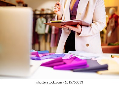the stylist conducts a color type procedure for a woman,personal consultation about color in clothing