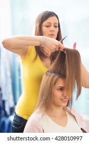 Stylist makeing haircut,under exposed photo