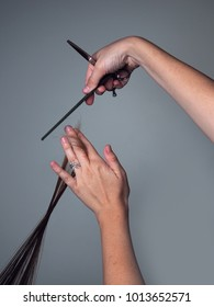 Stylist Measures Hair for a Trim
