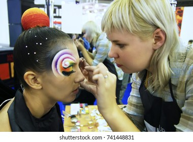Stylist performs artistic make-up