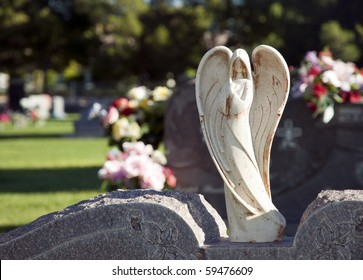 Stylized angel on a cemetery headstone