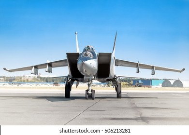 Stylized brutal front view of supersonic twin jet engine military fighter bomber interceptor aircraft warbird plane
