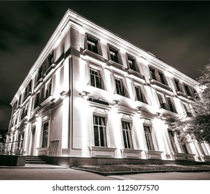 stylized commercial architecture at night