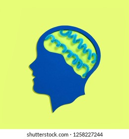 Stylized head silhouette. Blue spirals instead of brain. Blue aura is symbol of indigo children who are attributed to supernatural traits and abilities. Concept of mental health and disease
