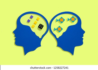 Stylized silhouettes of head. Symbolic image of work of brain. Left hemisphere is responsible for logical processes. Right hemisphere is responsible for holistic images. Minimal psychological concept