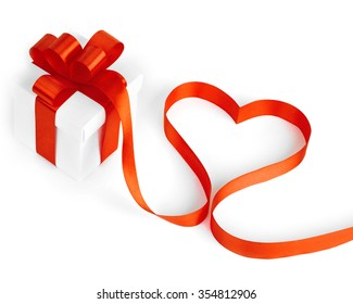 Stylized valentine heart made from red bow isolated on white background