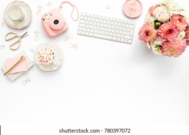 Stylized women's desk, office desk. Workspace with, laptop, bouquet dahlias, roses, clipboard. Women's fashion accessories isolated on white background. Flat lay Top view