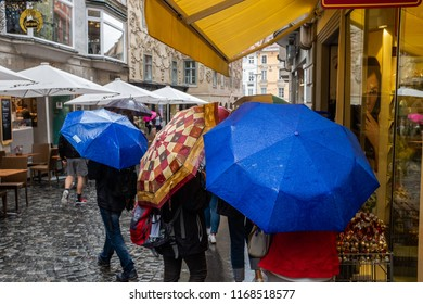 STYRIA, AUSTRIA - MAY 25, 2018: People carrying umbrellas on a rainy day