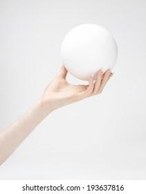 Styrofoam ball in hand