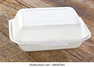 Styrofoam box for food on wooden table