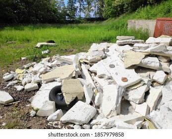 Styrofoam building insulation and car tyres abandoned in forest in Poland. Illegal garbage.