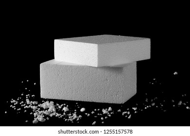 Styrofoam with crumbled pieces isolated on black background