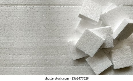 Styrofoam falls apart on Styrofoam, background styrofoam