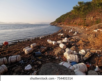 Styrofoam and other garbage on a beach. The photo was taken in South Korea, but it can be used for a wide variety of applications.
