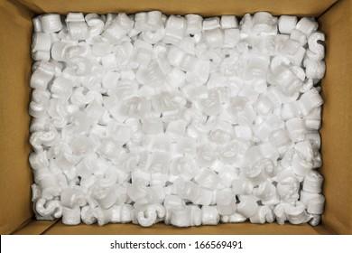 Styrofoam Packaging Peanuts Inside Cardboard Box Photo