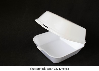 Styrofoam take-out food box on a black background