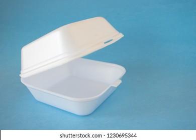 Styrofoam take-out food box on a blue background