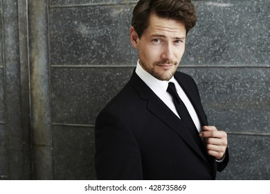 Suave businessman in black, portrait