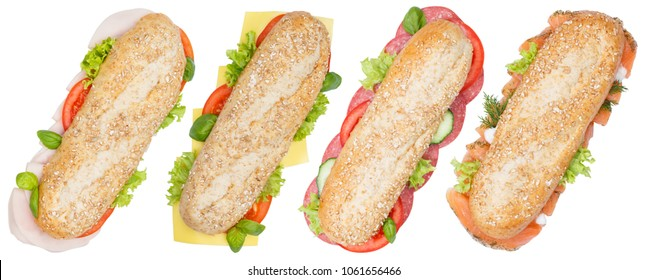 Sub sandwiches whole grains ham salami cheese salmon fish from above isolated on a white background