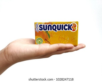 Subang Jaya , Malaysia - 15 February 2018 : Hand hold a box packet of Sunquick liquid flavor Mango isolated white background. Sunquick is a product of CO-RO A/S a Danish company.