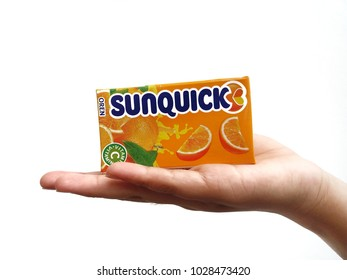 Subang Jaya , Malaysia - 15 February 2018 : Hand hold a box packet of Sunquick liquid flavor Orange over white background. Sunquick is a product of CO-RO A/S a Danish company.