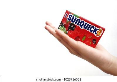 Subang Jaya , Malaysia - 15 February 2018 : Hand hold a box packet of Sunquick liquid flavor Berries over white background. Sunquick is a product of CO-RO A/S a Danish company.