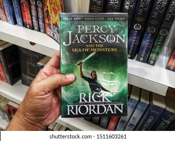 Subang Jaya, Malaysia - 15 September 2019 : Hand hold a RICK RIORDAN book title - PERCY JACKSON AND THE SEA OF MONSTERS for sale at library book stores with selective focus.