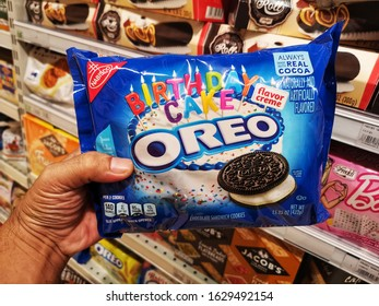 Subang Jaya, Malaysia - 20 January 2020 : Hand hold a packet of OREO Chocolate Sandwich Cookies for sell in the supermarket with selective focus.