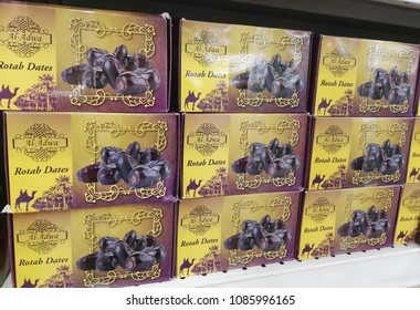 subang jaya - malaysia, 25 april 2018: fresh rotab dates fruits from al-adwa brand display for selling in market