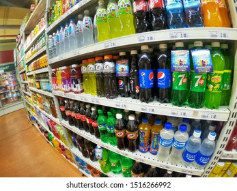 Subang Jaya, Malaysia - 25 August 2019 :Wide angle view a Soda Soft Drinks for sell in the supermarket shelves. Image contain certain grain or noise and soft focus. Wide angle photography.