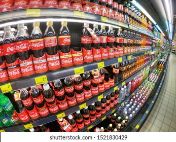 Subang Jaya, Malaysia - 25 August 2019 : Assortment of Soda drinks bottle display for sell in the supermarket shelves with selective focus. Wide angle photography.