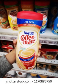 Subang Jaya, Malaysia - 26 August 2018 : Hand hold a bottle of The Original NESTLE Coffee-Mate Fat Free in the supermarket
