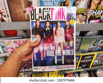 Subang Jaya, Malaysia - 30 April 2019 : Hand hold a BLACK PINK - K-Pop Queens Magazine for sell in the book stores with selective focus.