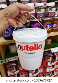 Subang Jaya, Malaysia - 30 April 2019 : Hand hold a pail of NUTELLA FERRERO - FOOD SERVICE for sell in the supermarket with selective focus.