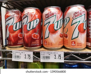 Subang Jaya, Malaysia - 30 April 2019 : Up close a 7up Cherry and Diet Cherry cans display for sale in the supermarket shelf with selective focus.