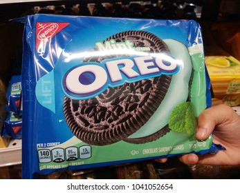 Subang Jaya , Malaysia - 4 March 2018 : Hand hold a packet of OREO chocolate sandwich cookies at the supermarket.