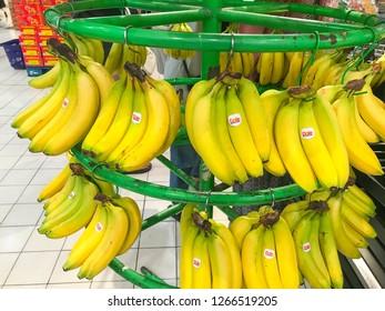 Subang Jaya, Malaysia - December 25, 2018; Yellow bananas on store shelf. Fruits grocery shopping. Selective focus.