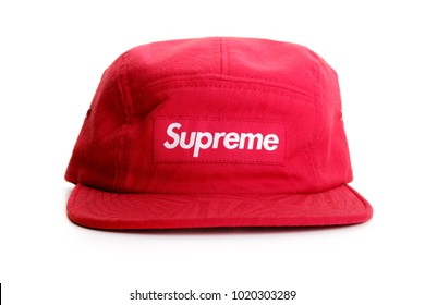 Subang Jaya, Malaysia - Feb 7, 2018: Red Supreme 5 panel cap on white background. Supreme is a skateboarding shop and clothing brand established in New York City in April 1994.