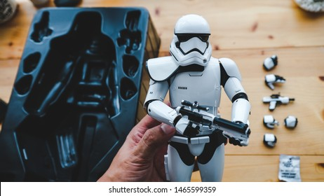 Subang Jaya, Malaysia - JULY 30, 2019: Unboxing new Starwars - Stormtrooper toy from Hot toys. This is high quality grade toy for adult collection.