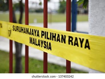SUBANG JAYA, MALAYSIA - MAY 5: Yellow barrier tape of the Malaysian election commission at a polling station for the Malaysian 13th general election on May 5, 2013 in Subang Jaya, Malaysia.