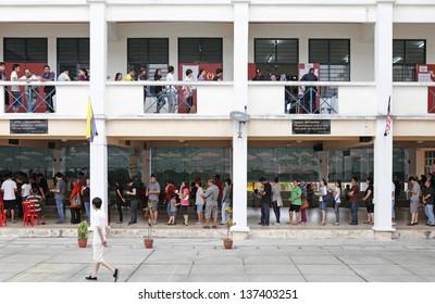 SUBANG JAYA, MALAYSIA - MAY 5: Malaysian citizens at a polling station for the Malaysian 13th general election on May 5, 2013 in Subang Jaya, Malaysia.