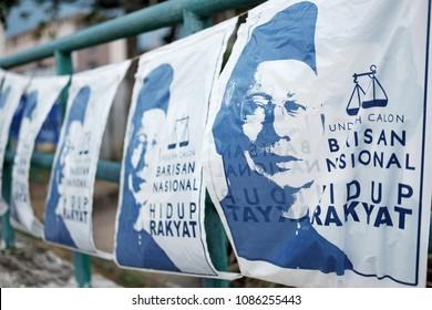 SUBANG JAYA, MALAYSIA - MAY 7, 2018: Barisan Nasional political bunting with Najib Razak face in Subang Jaya. Barisan Nasional is the incumbent political party in Malaysia 14th general election.