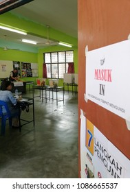 SUBANG JAYA, MALAYSIA - MAY 9, 2018: Election officers in a polling station in Subang Jaya, Malaysia. Malaysians are participating in the 14th Malaysian general election.