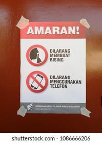 SUBANG JAYA, MALAYSIA - MAY 9, 2018: Facade of a polling station regulation signage in Subang Jaya, Malaysia. Malaysians are participating in the 14th Malaysian general election.