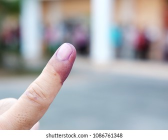 SUBANG JAYA, MALAYSIA - MAY 9, 2018: A finger mark with indelible ink at a polling station in Subang Jaya, Malaysia. Malaysians are participating in the 14th Malaysian general election.